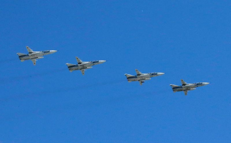 Su-24M front-line bombers fly in formation during Victory Day parade in Moscow