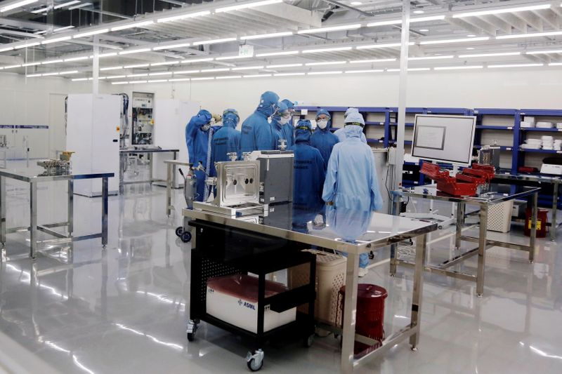 Trainees learn how to build and operate an EUV machine at the training center at ASML Holding in Tainan,