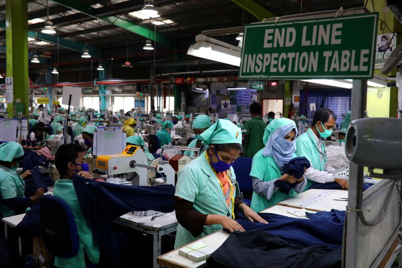 FILE PHOTO: Garment employees work at Fakhruddin Textile Mills Limited in Gazipur