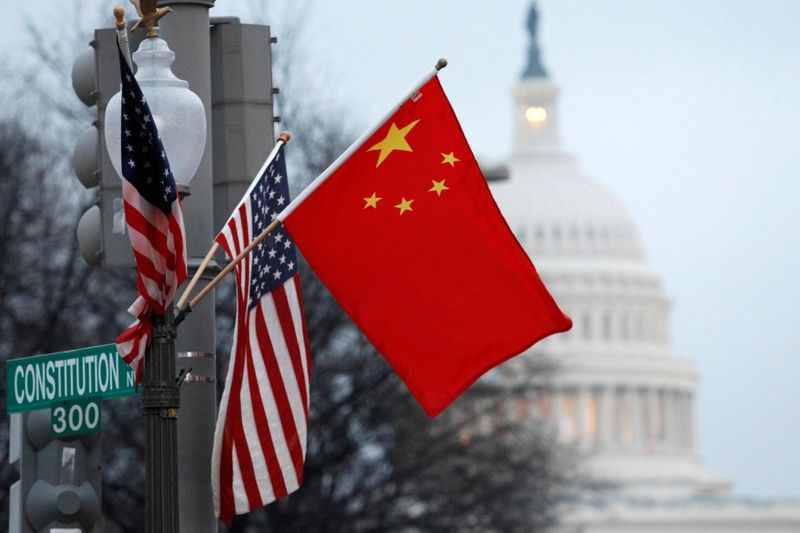 FILE PHOTO: The People's Republic of China flag and the U.S. Stars and Stripes fly on a lamp post along Pennsylvania Avenue near the U.S. Capitol in Washington