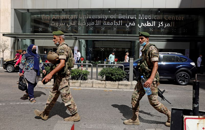 FILE PHOTO: Lebanese army soldiers walk as they secure the area, outside American University of Beirut (AUB) medical centre in Beirut