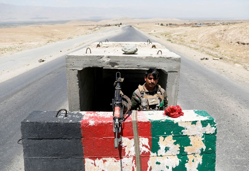 FILE PHOTO: Afghan National Army soldier stands guard at checkpoint near Bagram U.S. air base