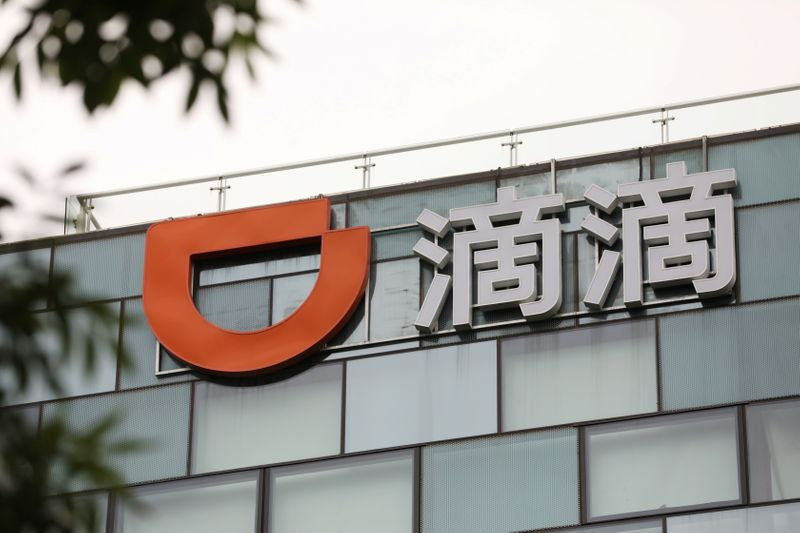Sign of Chinese ride-hailing service Didi is seen on its headquarters in Beijing,