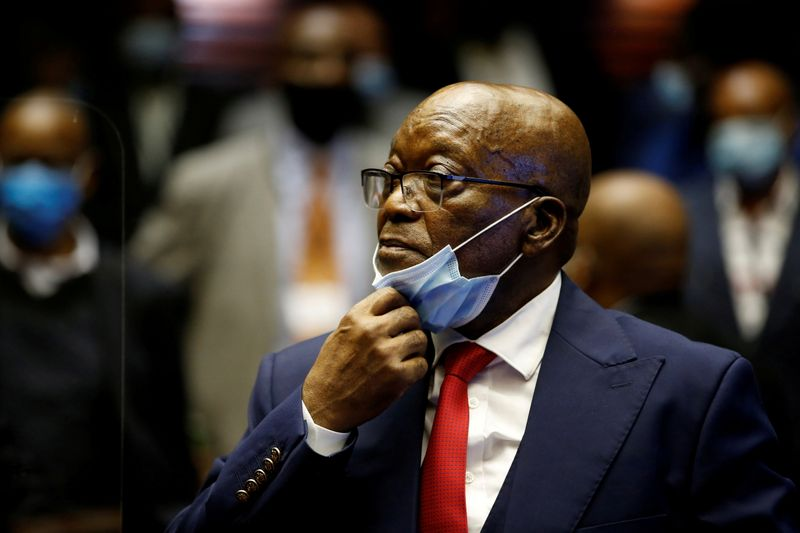 FILE PHOTO: Former South African President Jacob Zuma stands in the dock after recess in his corruption trial in Pietermaritzburg