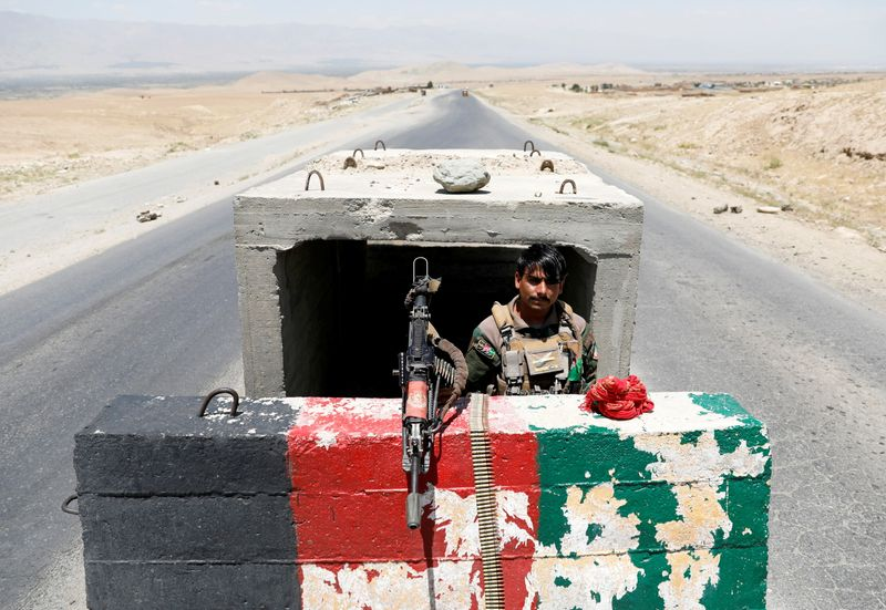 FILE PHOTO: An Afghan National Army soldier stands guard at a checkpoint near Bagram Air Base on the day the last American troops vacated it, in Parwan province, Afghanistan