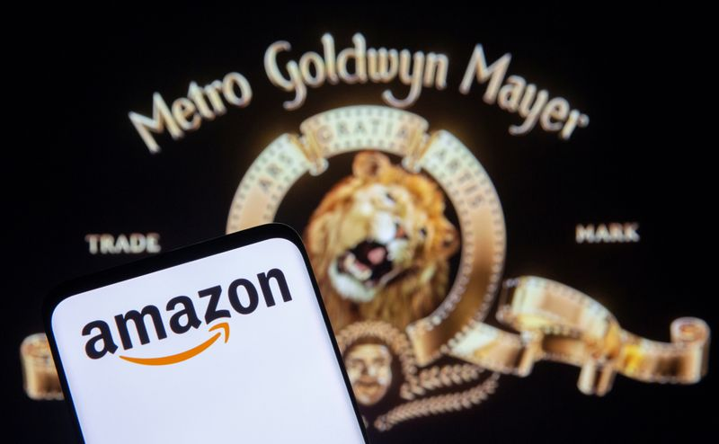 Smartphone with Amazon logo is seen in front of displayed MGM logo in this illustration taken