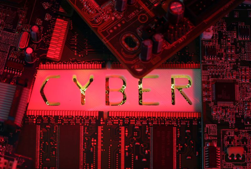 A 3D-printed Cyber word standing on PC motherboard is seen in this illustration picture,