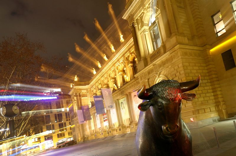 FILE PHOTO: The bull, symbol for successful trading, is seen in front of the German stock exchange in Frankfurt