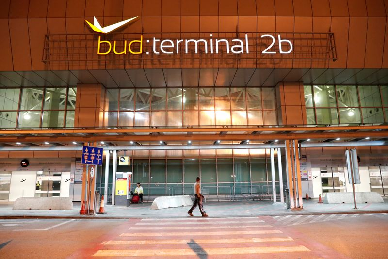 A man walks in front of the Budapest Airport's terminal 2B