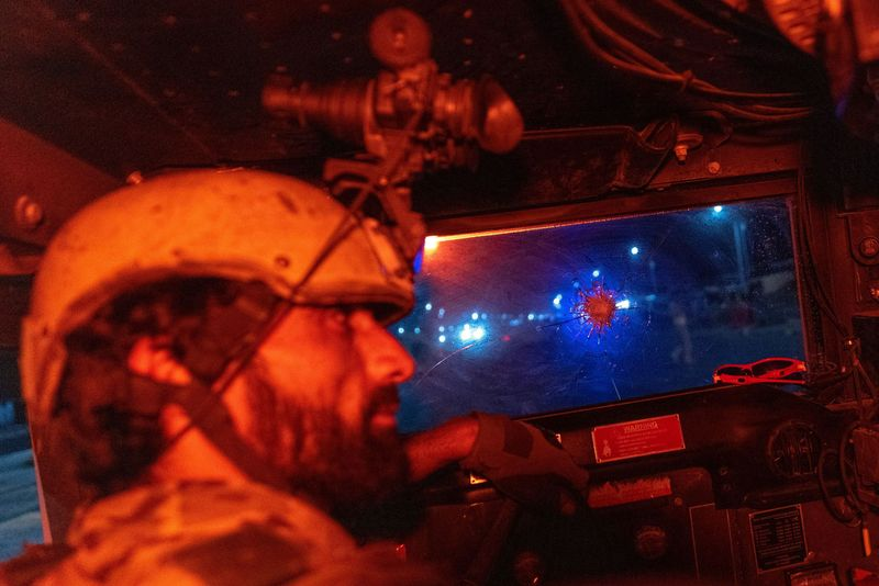 A member of the Afghan Special Forces drives a humvee during a combat mission against Taliban, in Kandahar province