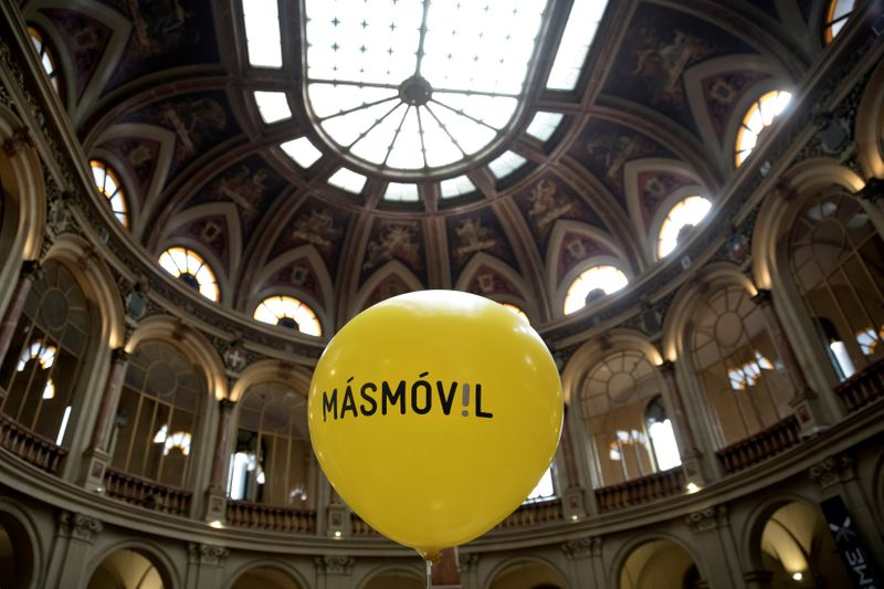 FILE PHOTO: A balloon with the logo of  Masmovil is seen during its bourse debut in 2017 in Madrid, Spain