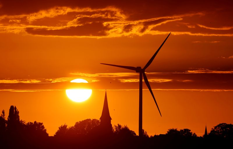 FILE PHOTO: A power-generating windmill turbine is pictured during sunset at a renewable energy park in Ecoust-Saint-Mein, France