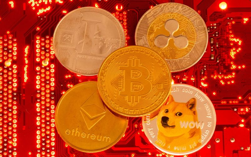 FILE PHOTO: Representations of cryptocurrencies Bitcoin, Ethereum, DogeCoin, Ripple, Litecoin are seen in this illustration