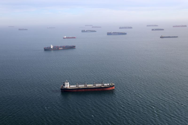 Container ships and oil tankers wait in the ocean outside the Port of Long Beach-Port of Los Angeles complex, amid the coronavirus disease (COVID-19) pandemic, in Los Angeles