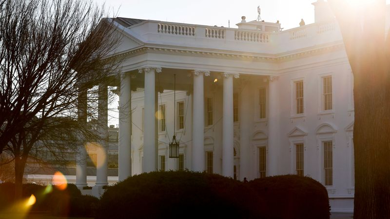 FILE PHOTO: A general view of the sun rising behind the White House in Washington
