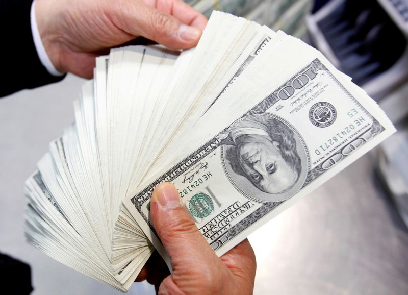FILE PHOTO: U.S. $100 notes are shown at the Korea Exchange Bank headquarters