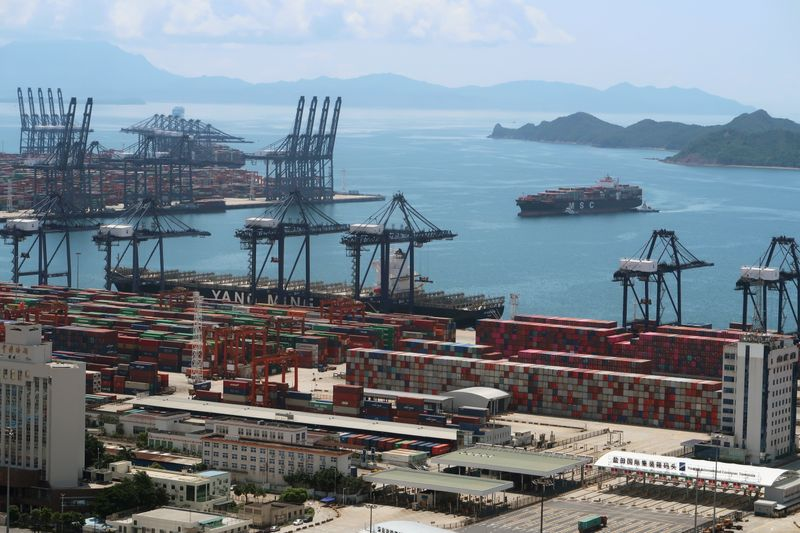 FILE PHOTO: FILE PHOTO: Cargo ship carrying containers is seen near the Yantian port in Shenzhen, following the novel coronavirus disease (COVID-19) outbreak, Guangdong