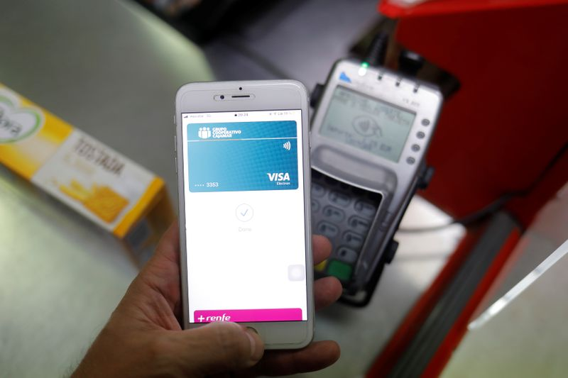 FILE PHOTO: A shopper uses the mobile payment service Apple Pay at a supermarket, amid the coronavirus disease (COVID-19) outbreak, in Ronda