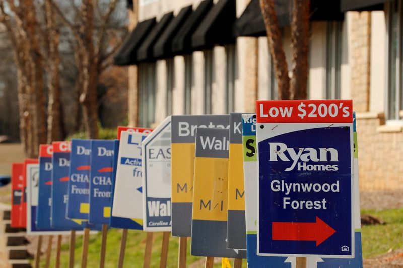 FILE PHOTO: Real estate signs advertise new homes for sale in multiple new developments in York County, South Carolina