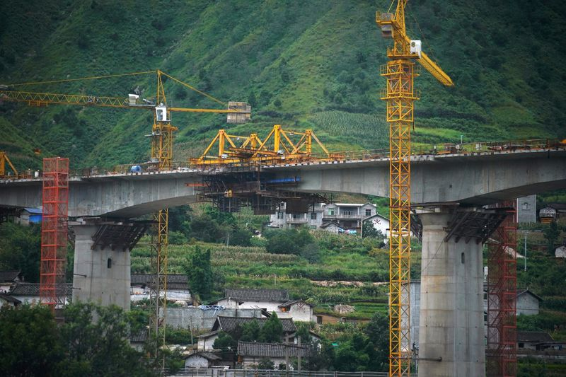 Construction site of a bridge is seen during a government-organised media tour in Liangshan Yi Autonomous Prefecture, Sichuan