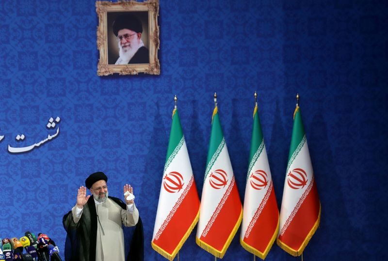 FILE PHOTO: Iran's President-elect Ebrahim Raisi gestures at a news conference in Tehran