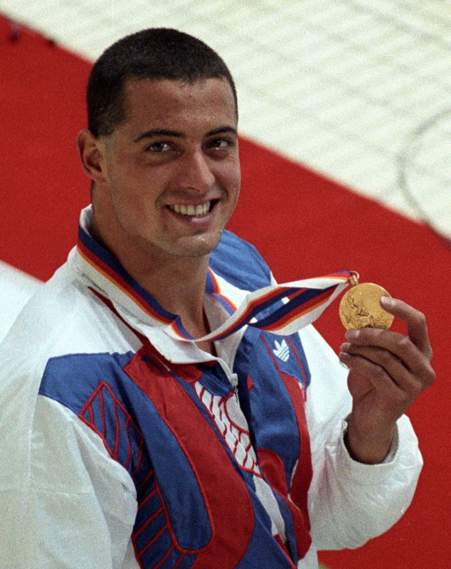 FILE PHOTO: Matt Biondi of the USA smiles as he shows the gold medal that he won in the men's 100 metres freestyle