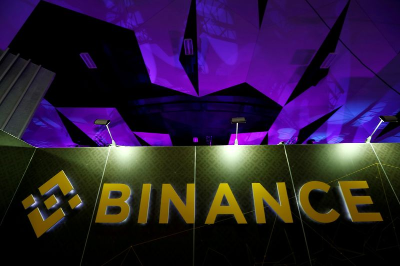 FILE PHOTO: The logo of Binance is seen on their exhibition stand at the Delta Summit, Malta's official Blockchain and Digital Innovation event promoting cryptocurrency, in St Julian's