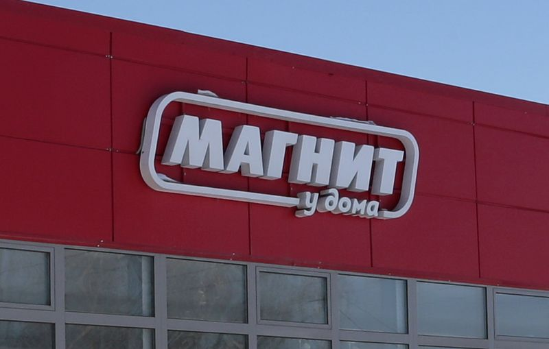 FILE PHOTO: The logo of Russian retailer Magnit is seen on a grocery store outside Moscow