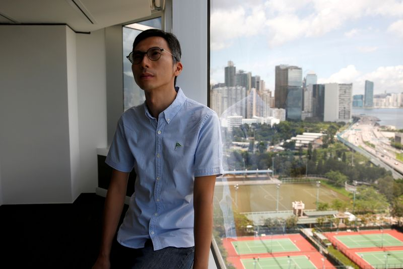 FILE PHOTO: Hong Kong film director Kiwi Chow poses after interview with Reuters, in Hong Kong