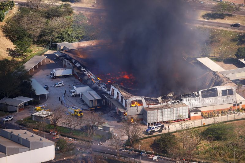 FILE PHOTO: A general view of the burning warehouse in Durban