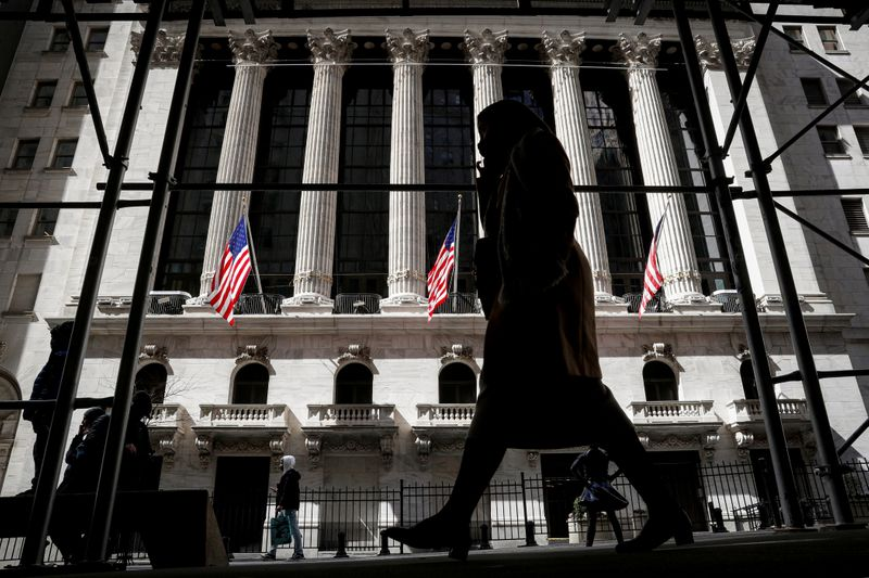 FILE PHOTO: People are seen outside the NYSE in New York