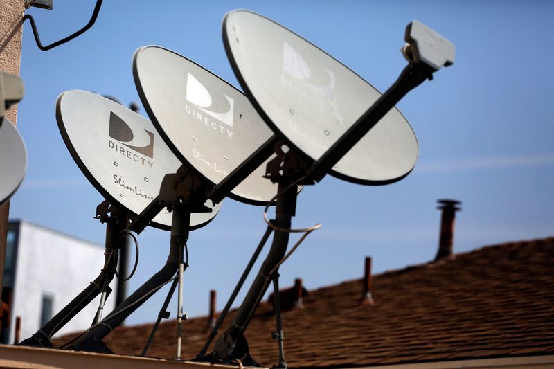 FILE PHOTO: DirecTV satellite dishes are seen on an apartment roof in Los Angeles