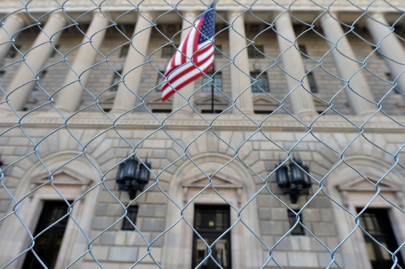 FILE PHOTO: A fence surrounds the U.S. Department of Commerce in Washington