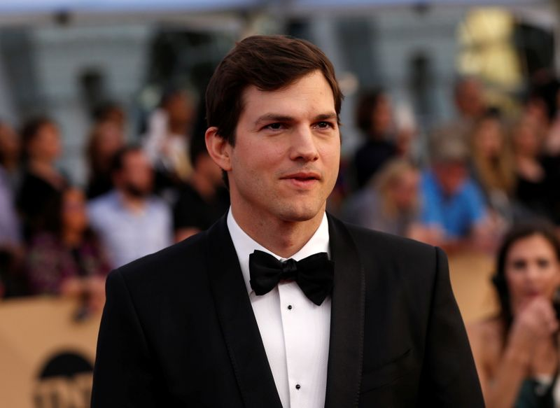 FILE PHOTO: Actor Ashton Kutcher arrives at the 23rd Screen Actors Guild Awards in Los Angeles