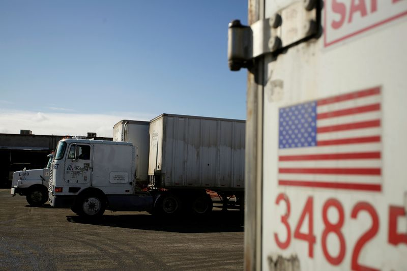 FILE PHOTO: A U.S. flag is picture on a truck loaded with merchandise at the freight shipping company Sotelo, which transports goods between Mexico and the United States, in Ciudad Juarez