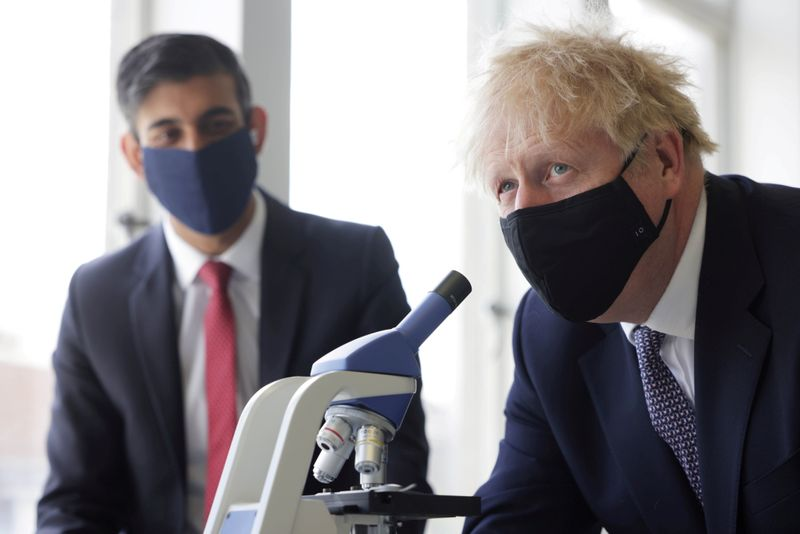 FILE PHOTO: Britain's PM Johnson and Chancellor of the Exchequer Sunak visit school in London