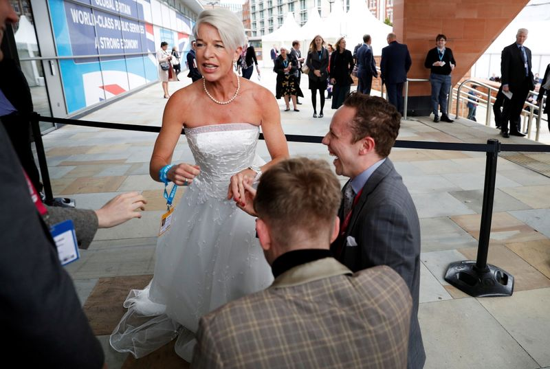 FILE PHOTO: Newspaper columnist Katie Hopkins arrives dressed in a wedding dress at the Conservative Party's conference in Manchester