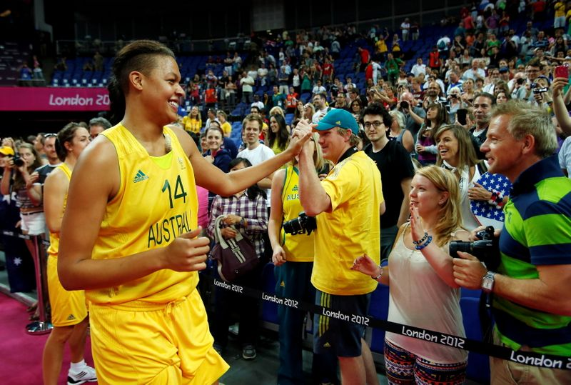 FILE PHOTO: Australia's Cambage celebrates with fans after the women's bronze medal basketball match against Russia at the North Greenwich Arena during the London 2012 Olympic Games