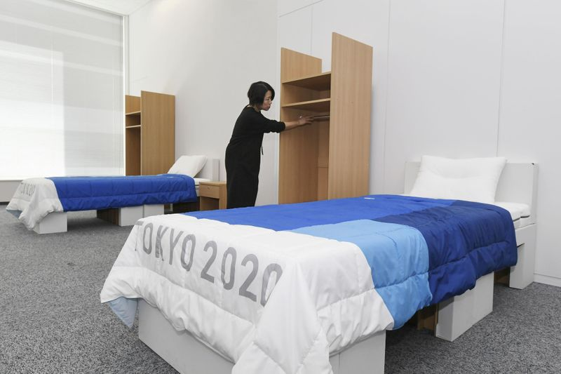 The beds to be used by the athletes at the Tokyo 2020 Olympic and Paralympic Games, made partially from recyclable cardboard, are displayed during a press preview in Tokyo