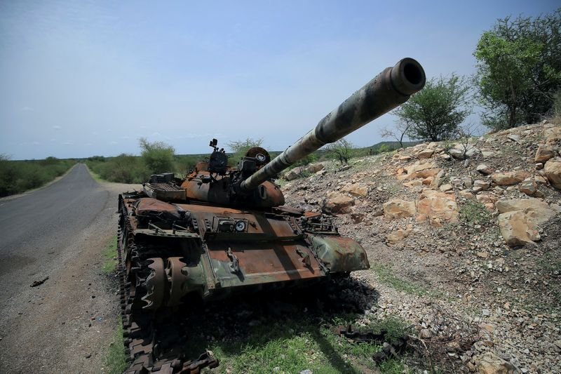 FILE PHOTO: FILE PHOTO: A tank damaged during the fighting between Ethiopia's National Defense Force (ENDF) and Tigray Special Forces stands on the outskirts of Humera town