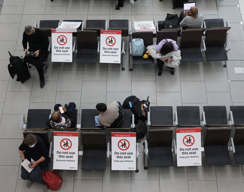 Passengers socially distanced at Heathrow Airport