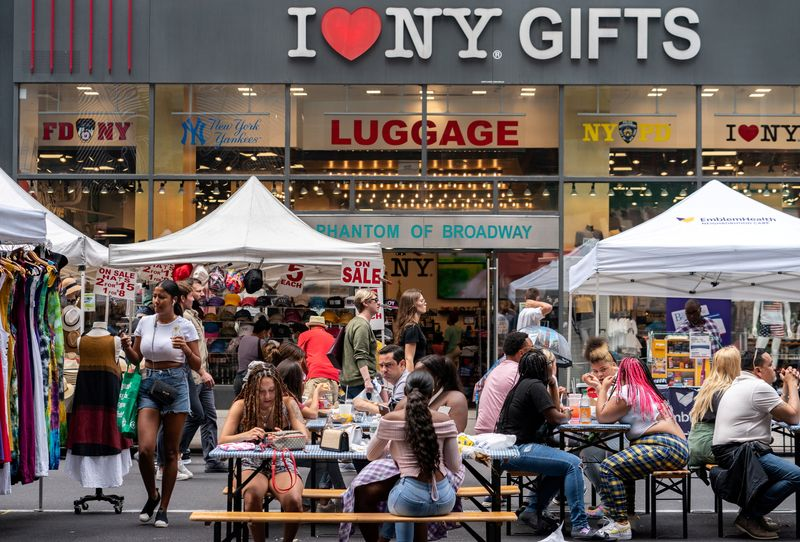 FILE PHOTO: People shop at a street fair near Times Square in New York City