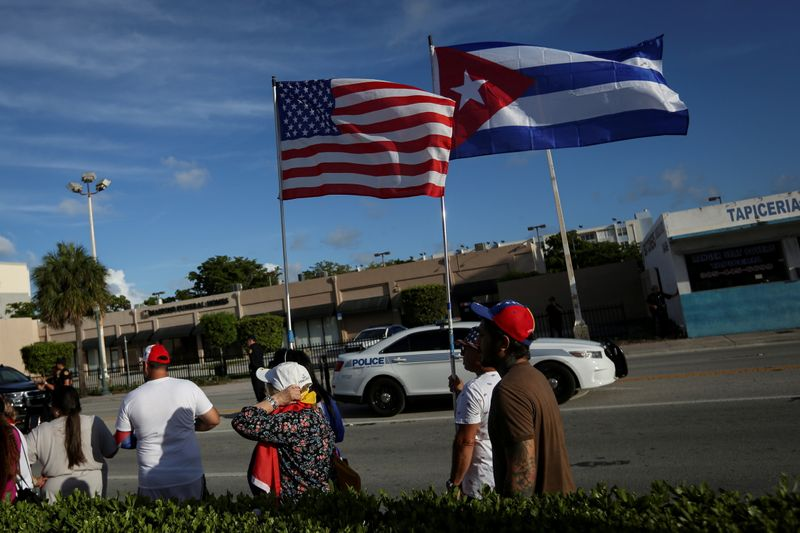 FILE PHOTO: Emigres react to reports of protests in Cuba against its deteriorating economy, in Miami, Florida