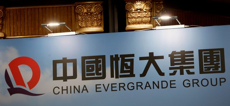 FILE PHOTO: A logo of China Evergrande Group is displayed at a news conference on the property developer's annual results in Hong Kong