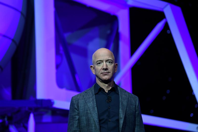 FILE PHOTO: Founder, Chairman, CEO and President of Amazon Jeff Bezos unveils his space company Blue Origin's space exploration lunar lander rocket called Blue Moon during an unveiling event in Washington
