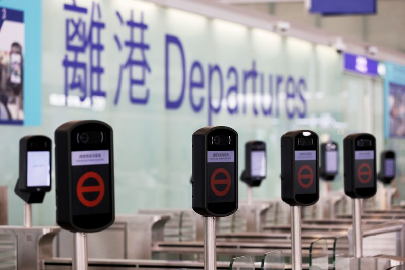FILE PHOTO: FILE PHOTO: Closed counters are seen at the departures hall of Hong Kong International Airport, following the coronavirus disease (COVID-19) outbreak, in Hong Kong, China