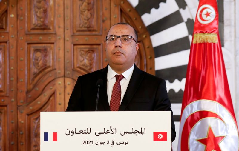 FILE PHOTO: Tunisian prime minister appears in news conference