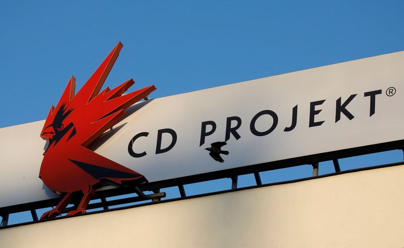 FILE PHOTO: A bird flies in front of the Cd Projekt logo at its headquarters in Warsaw