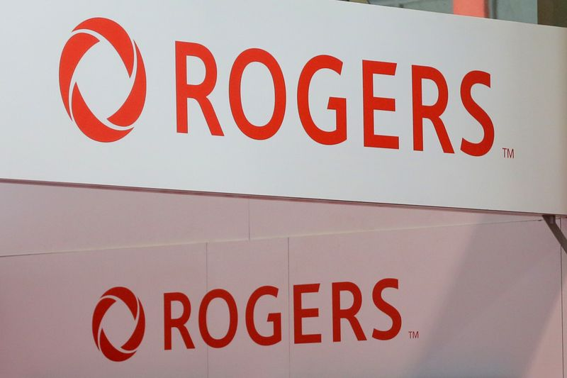 FILE PHOTO: Rogers Communications logos are seen above a booth at the Canadian International AutoShow in Toronto