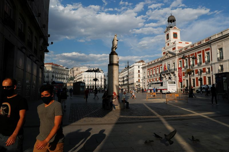 People hang out at Madrid's landmark Puerta del Sol square